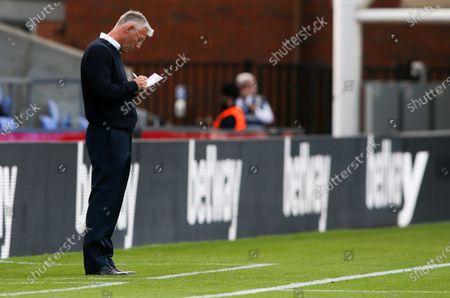 Manager Nigel Adkins of Charlton Athletic  makes some notes