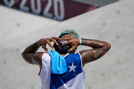 Manny Santiago of Puerto Rico cools off after competing in the men's street skateboarding at the 2020 Summer Olympics, in Tokyo, Japan