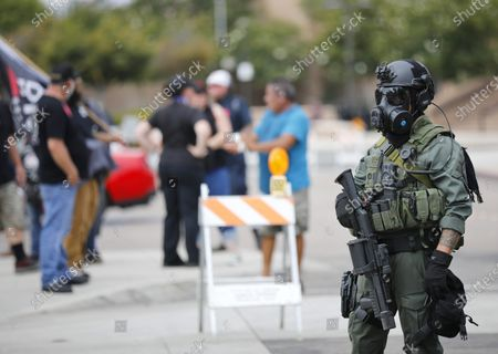 """Stock Image of El Cajon police in riot gear blocked off streets as Mike Pompeo, the former CIA director and secretary of state under Donald Trump, spoke at """"We Are Israel"""", a rally against antisemitism in El Cajon on Sunday, July 25, 2021."""