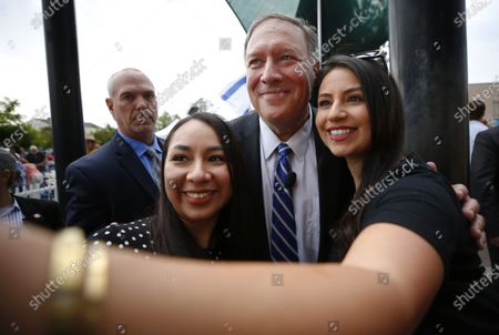 """Mike Pompeo, the former CIA director and secretary of state under Donald Trump, takes a photo with Christina Gomez of Mira Mesa, left, and Clarissa Rivera of Chula Vista at """"We Are Israel"""", a rally against antisemitism in El Cajon on Sunday, July 25, 2021."""
