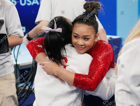 Simone Biles hugs Sunisa Lee after her balance beam performance at the women's artistic team all-around finals at the Tokyo 2020 Summer Olympic Games in Tokyo, Japan on Tuesday, July 27, 2021.