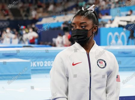 Simone Biles watches her team compete after pulling out of competitions at the women's artistic team all-around finals at the Tokyo 2020 Summer Olympic Games in Tokyo, Japan on Tuesday, July 27, 2021.