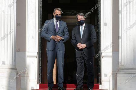 Greek prime minister Kyriakos Mitsotakis  (L) welcomes President of the republic of Cyprus Nikos Anastasiadis (R) at Maximos mansion, prior to their meeting in  Athens, Greece, 27 July 2021.