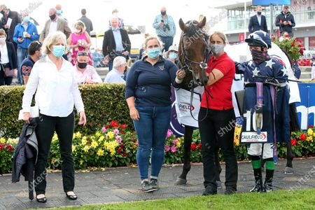 Stock Picture of The caulfieldindustrial.com Handicap. Moddy Poddle with Sheila Lavery, Michelle O'Neill, Marie McCarthy and Chris Hayes after winning