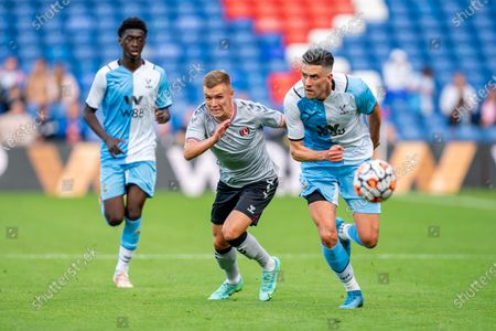 Stock Image of Crystal Palace defender Martin Kelly (34) beats Charlton Athletic forward Charles Clayden (11) to the ball during  the Pre-Season Friendly match between Crystal Palace and Charlton Athletic at Selhurst Park, London