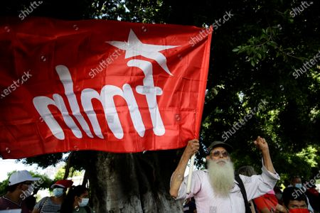 Supporters of the Farabundo Marti National Liberation Front (FMLN) demonstrate outside a judicial headquarters in San Salvador, El Salvador, 27 July 2021. A peace court installed the initial hearing against 10 former Salvadoran officials, including former President Salvador Sanchez Ceren - absent in the process-, on charges of corruption for allegedly receiving irregular payments in the administration of Mauricio Funes (2009-2014).