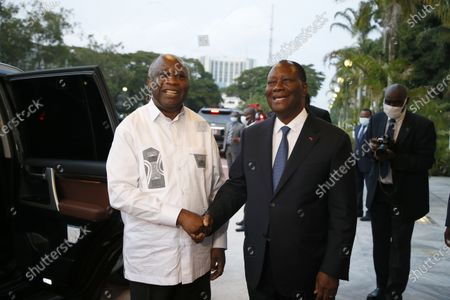 Ivorian President Alassane Ouattara (right) chats with Laurent Gbagbo (left), former Ivorian head of state during a meeting at the presidential palace in Abidjan, Côte d'Ivoire, 27 July 2021. Former Ivorian President Laurent Gbagbo, acquitted by the International Criminal Court (ICC) on 31 March 2021, arrived in Abidjan on 17 June 2021. This meeting was announced last week by the government spokesperson at the from a Council of Ministers.