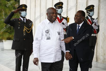 Stock Image of Ivorian President Alassane Ouattara (right) chats with Laurent Gbagbo (left), former Ivorian head of state during a meeting at the presidential palace in Abidjan, Côte d'Ivoire, 27 July 2021. Former Ivorian President Laurent Gbagbo, acquitted by the International Criminal Court (ICC) on 31 March 2021, arrived in Abidjan on 17 June 2021. This meeting was announced last week by the government spokesperson at the from a Council of Ministers.