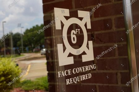 Face covering signage as well as the recommended social distancing of 6 ft., are posted on the COVID-19 vaccination site at the Rose E. McCoy Auditorium on the Jackson State University campus in Jackson, Miss., . The Centers for Disease Control and Prevention announced Tuesday, new recommendations that vaccinated people return to wearing masks indoors in parts of the U.S. where the coronavirus is surging and also recommended indoor masks for all teachers, staff, students and visitors to schools, regardless of vaccination status