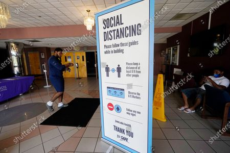 Social distancing as well as face covering is recommended at the COVID-19 vaccination site in the Rose E. McCoy Auditorium on the Jackson State University campus in Jackson, Miss., . The Centers for Disease Control and Prevention announced Tuesday, new recommendations that vaccinated people return to wearing masks indoors in parts of the U.S. where the coronavirus is surging and also recommended indoor masks for all teachers, staff, students and visitors to schools, regardless of vaccination status