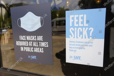 Face mask requirements are posted at the various entrances at the Rose E. McCoy Auditorium where COVID-19 vaccinations are being offered on the Jackson State University campus in Jackson, Miss., . The university has similar signage posted throughout the campus. The Centers for Disease Control and Prevention announced new recommendations that vaccinated people return to wearing masks indoors in parts of the U.S. where the coronavirus is surging and also recommended indoor masks for all teachers, staff, students and visitors to schools, regardless of vaccination status