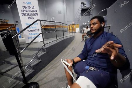 Timontre Graham, 21, a senior at Jackson State and a defensive lineman with the football team, said he was reluctant to receive the COVID-19 vaccination, but after being quarantined earlier this year and missing almost two-weeks of football, he said he was not taking any chances this fall, as he waited during the observation period following his vaccination at the Rose E. McCoy Auditorium on Jackson, Miss., campus, . An open vaccination site was partnered by the university and the Jackson-Hinds Comprehensive Health Center