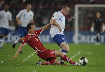 Wayne Rooney of England and Steven von Bergen of Switzerland