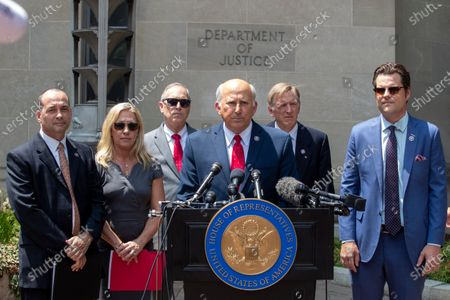 Republican Representative Louie Gohmert (3-R) from Texas, with Marjorie Taylor Greene (2-L) from Arizona, Matt Gaetz (R) from Florida, Paul Gosar (2-R) from Arizona and others, delivers remarks during a press conference outside the Justice Department about the treatment of who they called 'January 6th prisoners' in Washington, DC, USA, 27 July, 2021. The Republicans Representatives Marjorie Taylor Greene from Arizona, Matt Gaetz from Florida, Paul Gosar from Arizona, Louie Gohmert from Texas and others, have propagated conspiracy theories about who was behind the January 6th insurrection. Across town at the Cannon House Office Building, members of the Select Committee to Investigate the January 6th Attack on the US Capitol held their first hearing today, hearing from members of the US Capitol Police and the Metropolitan Police Department who tried to protect the Capitol against insurrectionists.
