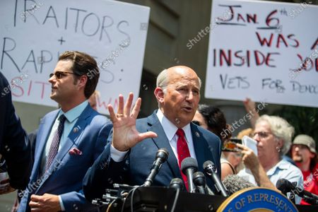 Republican Representative Louie Gohmert (R) from Texas, with Matt Gaetz (L) from Florida, delivers remarks as protesters take over a press conference outside the Justice Department about the treatment of who they called 'January 6th prisoners' in Washington, DC, USA, 27 July, 2021. The Republicans Representatives Marjorie Taylor Greene from Arizona, Matt Gaetz from Florida, Paul Gosar from Arizona, Louie Gohmert from Texas and others, have propagated conspiracy theories about who was behind the January 6th insurrection. Across town at the Cannon House Office Building, members of the Select Committee to Investigate the January 6th Attack on the US Capitol held their first hearing today, hearing from members of the US Capitol Police and the Metropolitan Police Department who tried to protect the Capitol against insurrectionists.