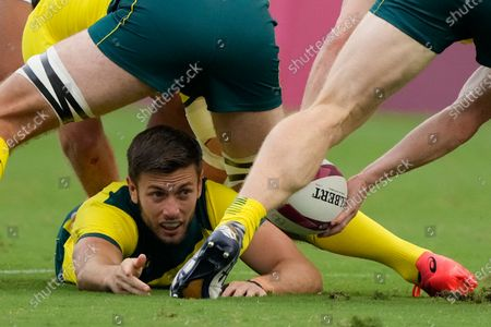 Stock Photo of Australia's Josh Turner feeds the ball out, in Australia's men's rugby sevens 5-8 placing match against South Africa at the 2020 Summer Olympics, in Tokyo, Japan
