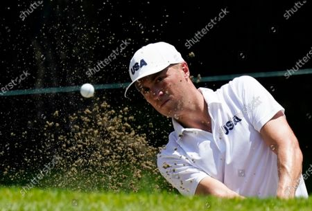 United States' Justin Thomas plays a shot from a bunker during a practice round of the men's golf event at the 2020 Summer Olympics, at the Kasumigaseki Country Club in Kawagoe, Japan