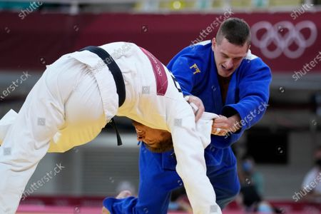 Noel van T End of Netherlands, left, and Michael Zgank of Turkey compete during the men -90kg quarterfinal round of the judo match at the 2020 Summer Olympics in Tokyo, Japan