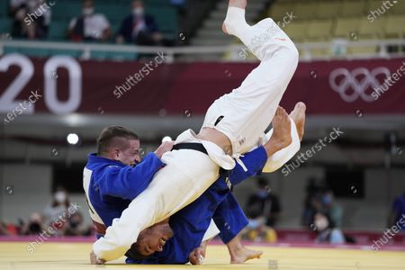 Noel van T End of Netherlands, front, and Michael Zgank of Turkey compete during the men -90kg quarterfinal round of the judo match at the 2020 Summer Olympics in Tokyo, Japan
