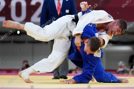 Noel van T End of Netherlands, top, and Michael Zgank of Turkey compete during the men -90kg quarterfinal round of the judo match at the 2020 Summer Olympics in Tokyo, Japan