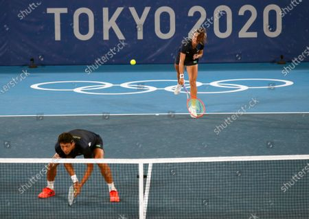 Stefani Luisa (R) and Marcelo Melo (L) of Brazil in action against Nina Stojanovic and Novak Djokovic of Serbia during their Mixed Doubles First Round Tennis match of the Tokyo 2020 Olympic Games at the Ariake Coliseum in Tokyo, Japan, 28 July 2021.