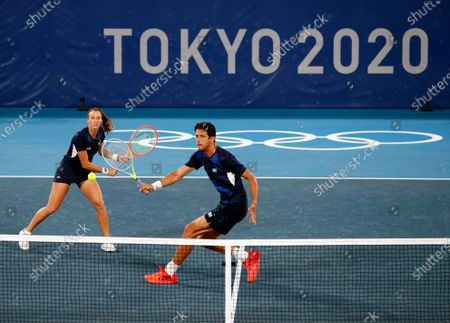 Marcelo Melo (R) and Stefani Luisa (L) of Brazil in action against Nina Stojanovic and Novak Djokovic of Serbia during their Mixed Doubles First Round Tennis match of the Tokyo 2020 Olympic Games at the Ariake Coliseum in Tokyo, Japan, 28 July 2021.
