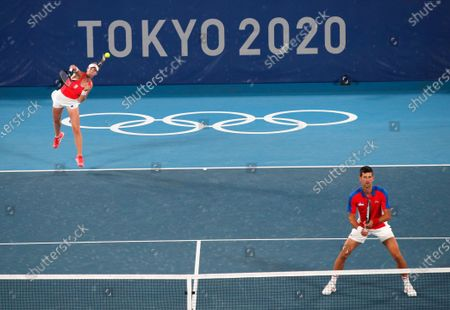 Stock Photo of Nina Stojanovic (L) and Novak Djokovic (R) of Serbia in action against Stefani Luisa and Marcelo Melo of Brazil during their Mixed Doubles First Round Tennis match of the Tokyo 2020 Olympic Games at the Ariake Coliseum in Tokyo, Japan, 28 July 2021.