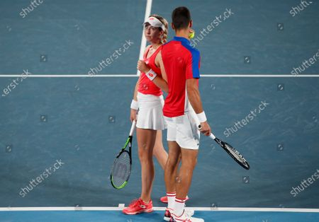 Stock Image of Novak Djokovic (R) and Nina Stojanovic (L) of Serbia speak during their Mixed Doubles First Round Tennis match against Stefani Luisa and Marcelo Melo of Brazil at the Tokyo 2020 Olympic Games at the Ariake Coliseum in Tokyo, Japan, 28 July 2021.