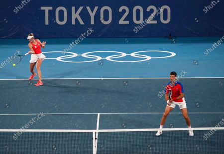 Novak Djokovic (R) and Nina Stojanovic (L) of Serbia in action against Stefani Luisa and Marcelo Melo of Brazil during their Mixed Doubles First Round Tennis match of the Tokyo 2020 Olympic Games at the Ariake Coliseum in Tokyo, Japan, 28 July 2021.