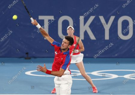 Novak Djokovic (Front) and Nina Stojanovic (Back) of Serbia in action against Stefani Luisa and Marcelo Melo of Brazil during their Mixed Doubles First Round Tennis match of the Tokyo 2020 Olympic Games at the Ariake Coliseum in Tokyo, Japan, 28 July 2021.