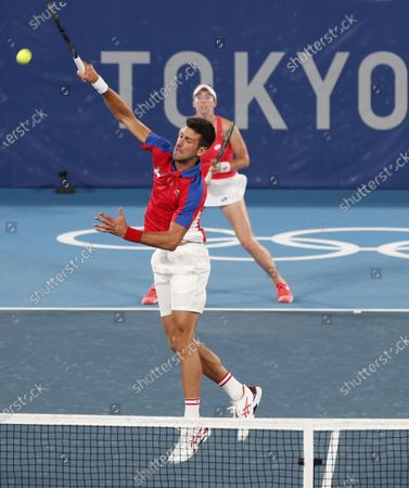 Stock Picture of Novak Djokovic (Front) and Nina Stojanovic (Back) of Serbia in action against Stefani Luisa and Marcelo Melo of Brazil during their Mixed Doubles First Round Tennis match of the Tokyo 2020 Olympic Games at the Ariake Coliseum in Tokyo, Japan, 28 July 2021.