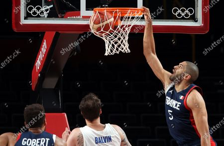 Nicolas Batum (R) of France in action during the Men's Basketball preliminary round Group B match between Czech Republic and France at the Tokyo 2020 Olympic Games at the Saitama Super Arena in Saitama, Japan, 28 July 2021.