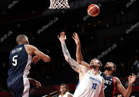 Nicolas Batum (L) of France in action against Ondrej Balvin (C) of Czech Republic during the Men's Basketball preliminary round Group B match between Czech Republic and France at the Tokyo 2020 Olympic Games at the Saitama Super Arena in Saitama, Japan, 28 July 2021.