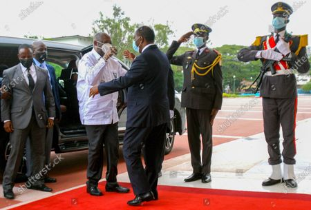 Former Ivory Coast President Laurent Gbagbo, left, is greeted by Ivory Coast's President Alassane Ouattara at the presidential palace in Abidjan . The meeting of the two leaders was highly anticipated and was an attempt to ease political tensions that have been present since their last meeting more than a decade ago, when Ouattara defeated Gbagbo in presidential elections