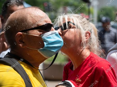 A protester of the House Republicans Jan 6th press conference uses a whistle to disrupt the speeches, he is confronted by a Trump supporter.