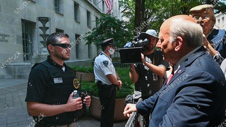 Stock Image of Louie Gohmert Hold Press Conference on Jan. 6th At DOJ, but their presser is interrupted by protesters.