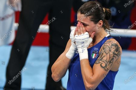 (210728) - TOKYO, July 28, 2021 (Xinhua) - Irma Testa of Italy reacts after winning the boxing women's feather (54-57kg) quarterfinal against Caroline Veyre of Canada at the Tokyo 2020 Olympic Games in Tokyo, Japan, July 28, 2021.