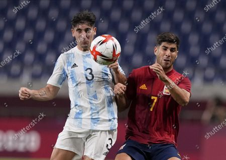 Stock Image of Spain's Marco Asensio, right, and Argentina's Claudio Bravo battle for the ball during a men's soccer match at the 2020 Summer Olympics, in Saitama, Japan