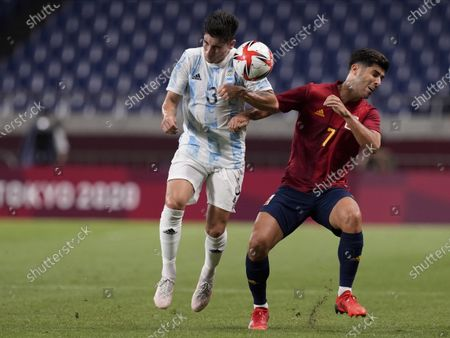 Stock Photo of Spain's Marco Asensio, right, and Argentina's Claudio Bravo battle for the ball during a men's soccer match at the 2020 Summer Olympics, in Saitama, Japan