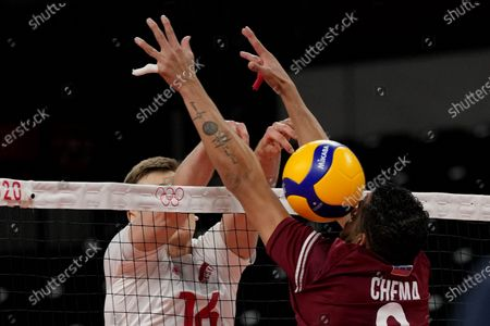 Stock Photo of Poland's Kamil Semeniuk, left, and Venezuela's Jose Manuel Carrasco Angulo challenge for the ball during the men's volleyball preliminary round pool A match between Poland and Venezuela at the 2020 Summer Olympics, in Tokyo, Japan