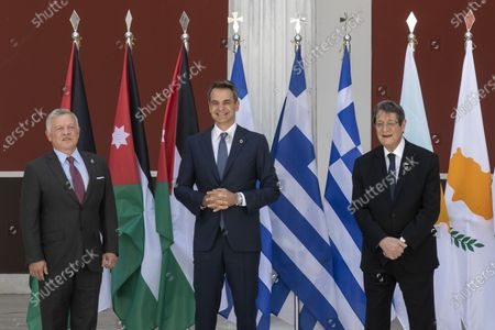 Jordan's King Abdullah II, left, Greece's Prime Minister Kyriakos Mitsotakis, center, and Cyprus' President Nikos Anastasiades pose for a group photo ahead of their meeting in Athens, on . Greece hosts a one-day trilateral meeting of the three leaders