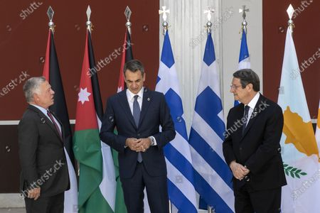 Stock Picture of Jordan's King Abdullah II, left, Greece's Prime Minister Kyriakos Mitsotakis, center, and Cyprus' President Nikos Anastasiades pose for a group photo ahead of their meeting in Athens, on . Greece hosts a one-day trilateral meeting of the three leaders