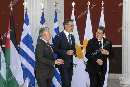 Stock Image of Jordan's King Abdullah II, left, Greece's Prime Minister Kyriakos Mitsotakis, center, and Cyprus' President Nikos Anastasiades make their way for a meeting in Athens, on . Greece is hosting a one-day trilateral meeting of the three leaders