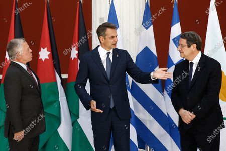 Greek Prime Minister Kyriakos Mitsotakis (C), King Abdullah of Jordan (L) and Cyprus President Nicos Anastasiades (R) talk as they pose for a family photo during the Trilateral Greece, Cyprus, Jordan Summit, in Athens, Greece, 28 July 2021.