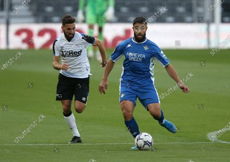 Stock Photo of Real Betis's Nabil Fekir holds off Derby County's Graeme Shinnie
