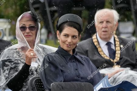 Home Secretary, Priti Patel (C) at The National Memorial Arboretum on July 28, 2021 in Stafford, England. The Police Memorial, designed by Walter Jack, commemorates the courage and sacrifice of members of the UK Police service who have dedicated their lives to protecting the public. The memorial is set on grounds landscaped by Charlotte Rathbone within the National Memorial Arboretum and stands along with 350 memorials for the armed forces, civilian organisations and voluntary bodies who have played their part serving the country.