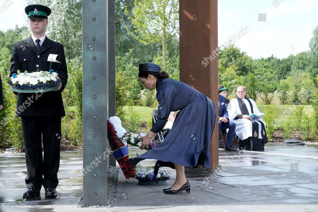 Home Secretary Priti Patel lays a wreath at the UK Police Memorial at The National Memorial Arboretum on July 28, 2021 in Stafford, England. The Police Memorial, designed by Walter Jack, commemorates the courage and sacrifice of members of the UK Police service who have dedicated their lives to protecting the public. The memorial is set on grounds landscaped by Charlotte Rathbone within the National Memorial Arboretum and stands along with 350 memorials for the armed forces, civilian organisations and voluntary bodies who have played their part serving the country.