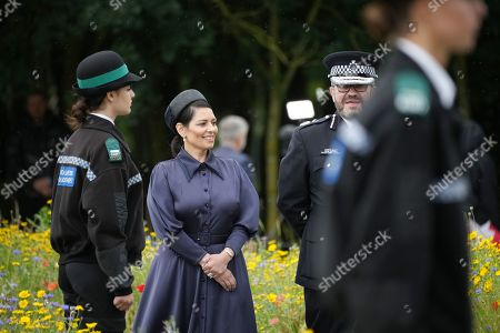 Home Secretary, Priti Patel at The National Memorial Arboretum on July 28, 2021 in Stafford, England. The Police Memorial, designed by Walter Jack, commemorates the courage and sacrifice of members of the UK Police service who have dedicated their lives to protecting the public. The memorial is set on grounds landscaped by Charlotte Rathbone within the National Memorial Arboretum and stands along with 350 memorials for the armed forces, civilian organisations and voluntary bodies who have played their part serving the country.
