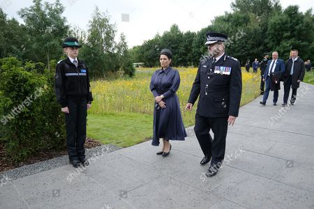 Home Secretary, Priti Patel walks with Martin Hewitt, Chair of the National Police Chiefsâ?? Council at The National Memorial Arboretum on July 28, 2021 in Stafford, England. The Police Memorial, designed by Walter Jack, commemorates the courage and sacrifice of members of the UK Police service who have dedicated their lives to protecting the public. The memorial is set on grounds landscaped by Charlotte Rathbone within the National Memorial Arboretum and stands along with 350 memorials for the armed forces, civilian organisations and voluntary bodies who have played their part serving the country.