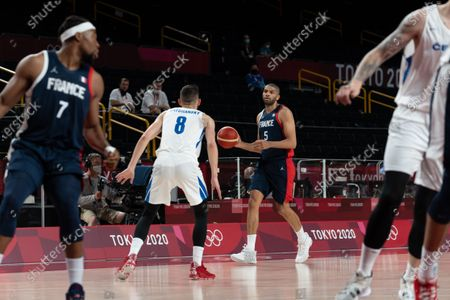 Nicolas Batum of Team France controls the ball during the men's preliminary round group A basketball match between Czech Republic and France during the Tokyo 2020 Olympic Games at the Saitama Super Arena in Saitama on July 28, 2021.